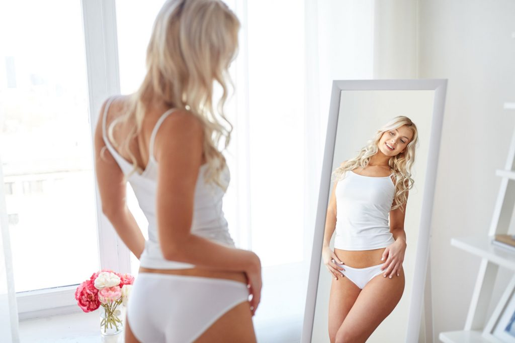 Fit Woman Facing Mirror